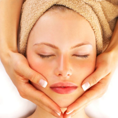Portrait of a young girl enjoying a healthy skin treatment at a spa resort.